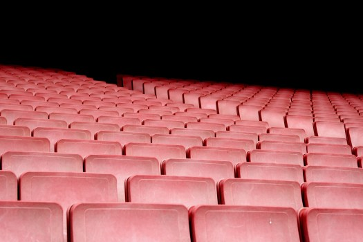 Red theatre seats with black background