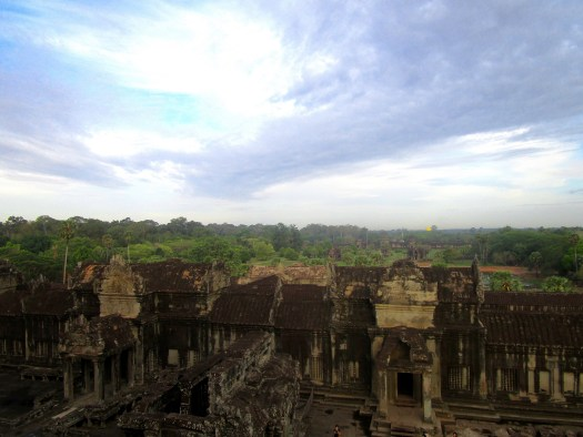 Rooftop views across Angkor Wat looking over temple ruins and forest land
