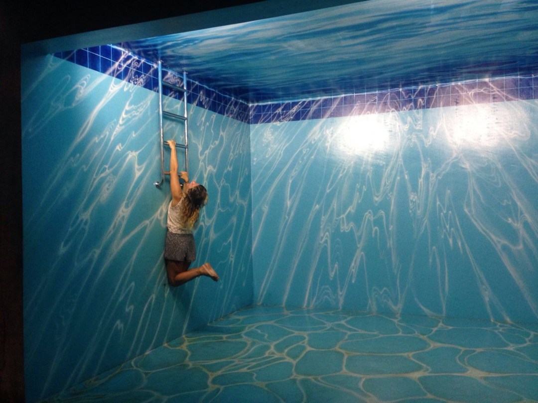 Immersive art work painted like the interior of a swimming pool