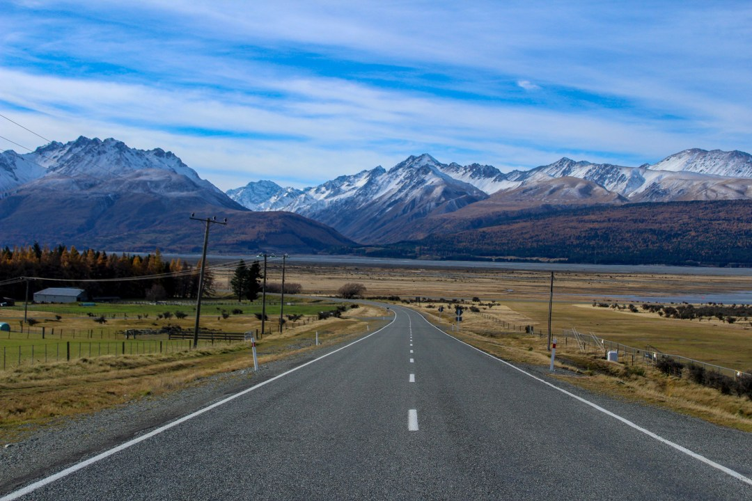 Mountain views ahead of a road in New Zealand