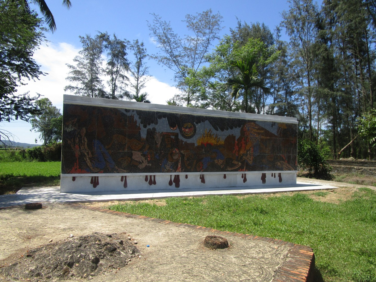 Historical Places to visit in Vietnam: My Lai Memorial. Where the village once stood is artwork to memorialise those who died here.