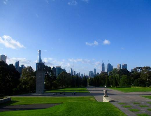 cityscape views of Melbourne Australia and tree-lined green grassy parks