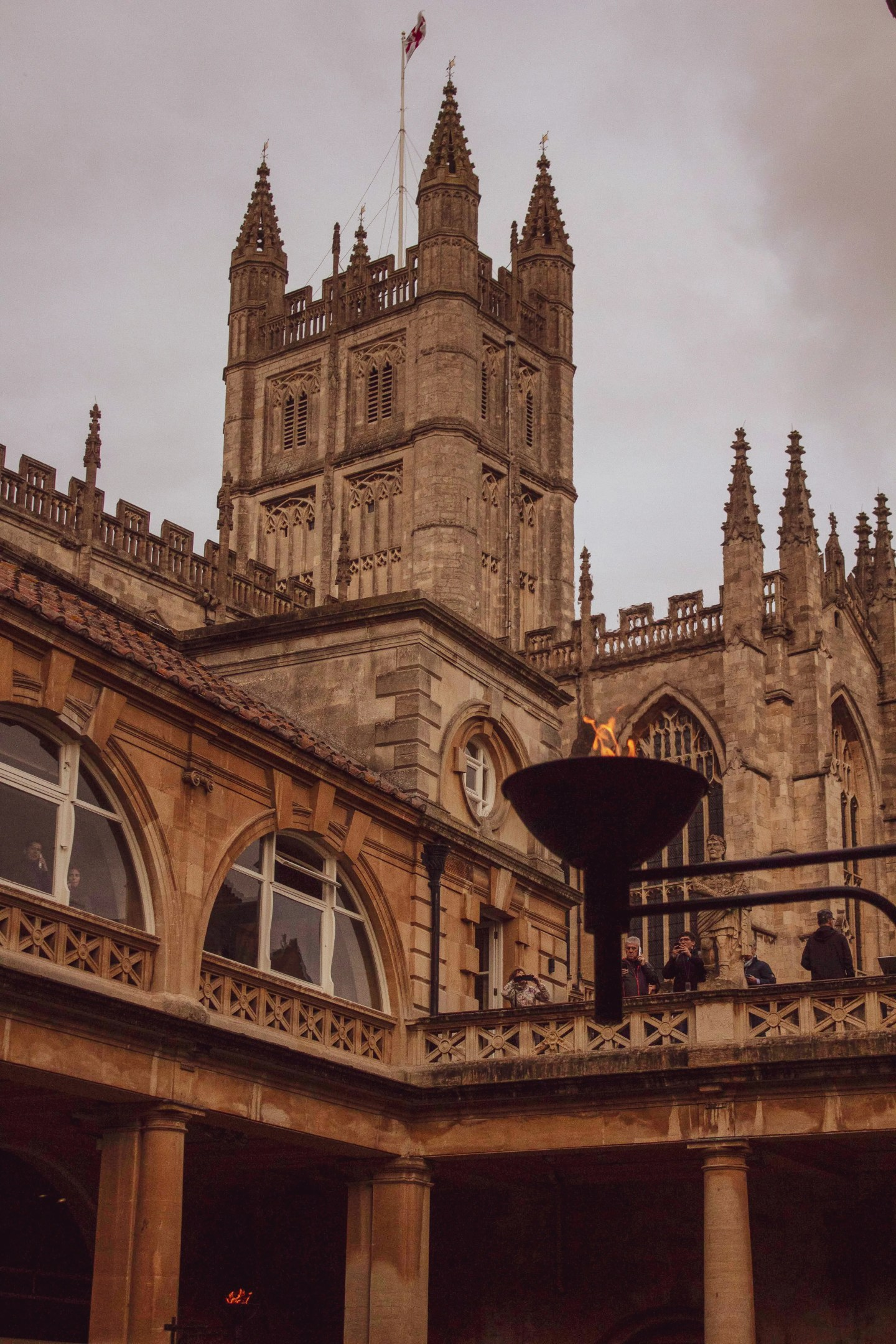 Bath Abbey tower seen from inside the Roman Baths with a beacon in front