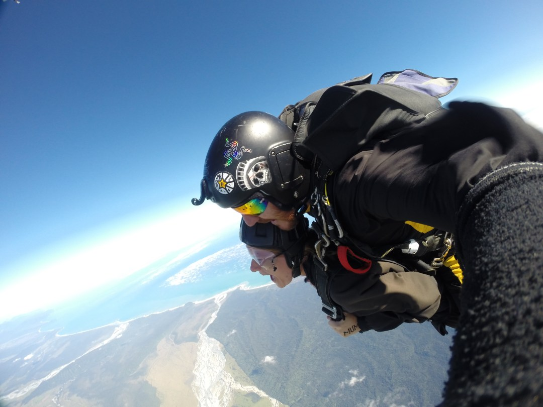 Tandem skydivers with ocean views from the air