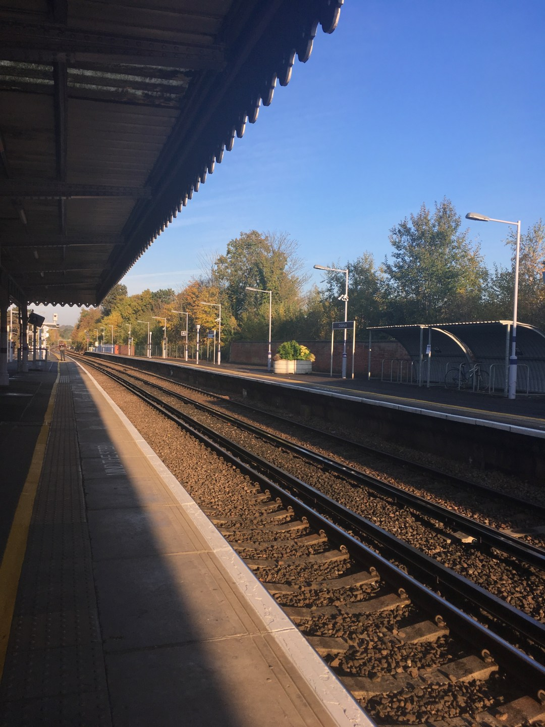 Blue skies and an empty station platform in London