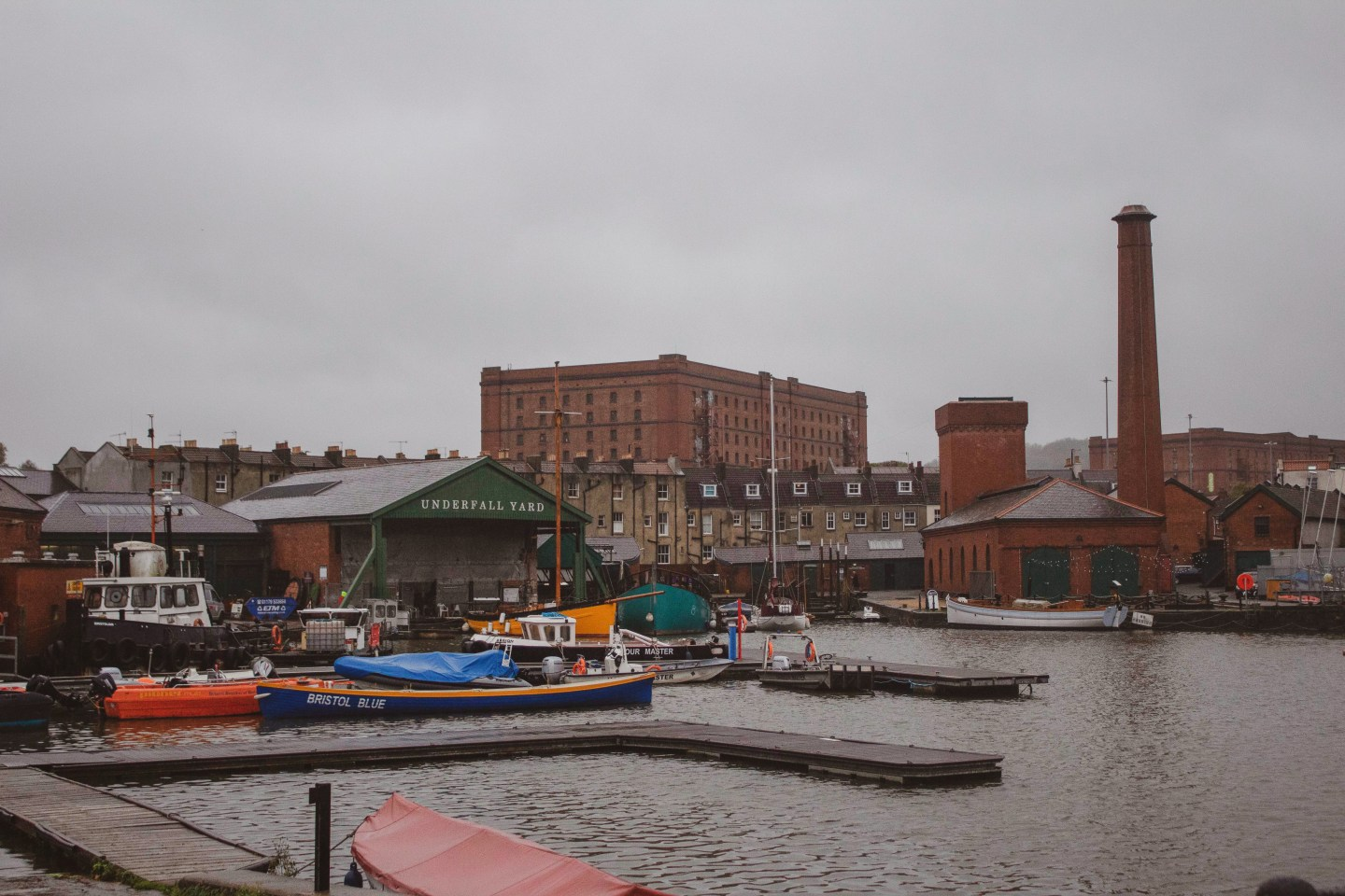 Underfell Yard in Bristol harbourside with boats and grey skies