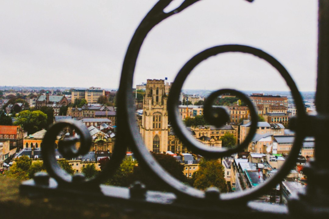 Will Memorial Building peeking through the railings of Cabot Tower
