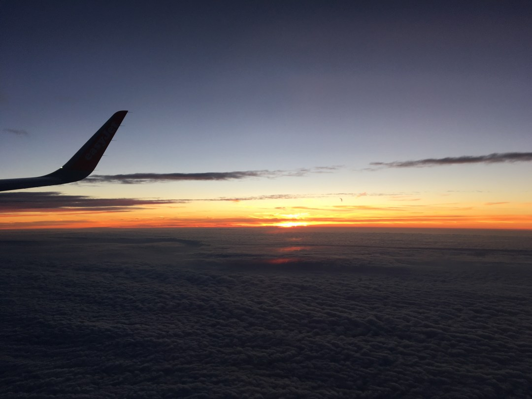 Flying from Bristol to Edinburgh sunrise over clouds