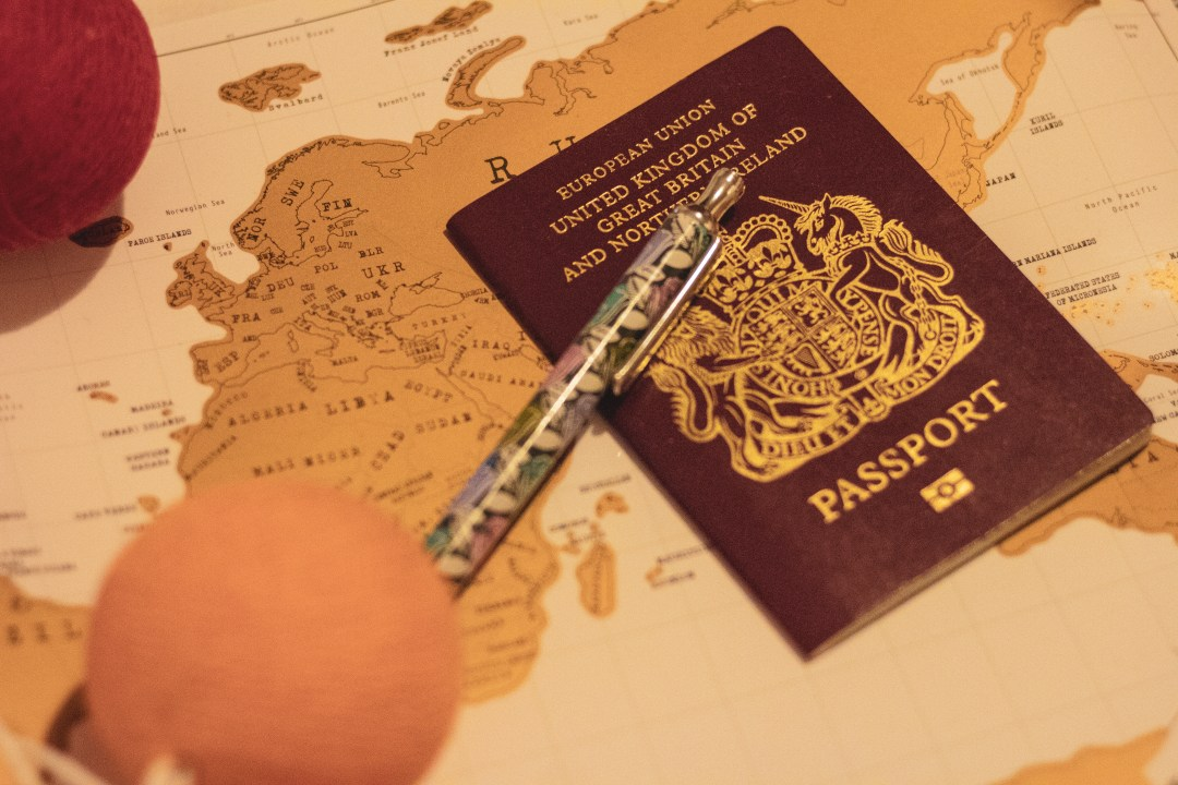 Pen and passport on map