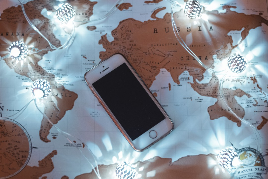 Phone and fairy lights on map