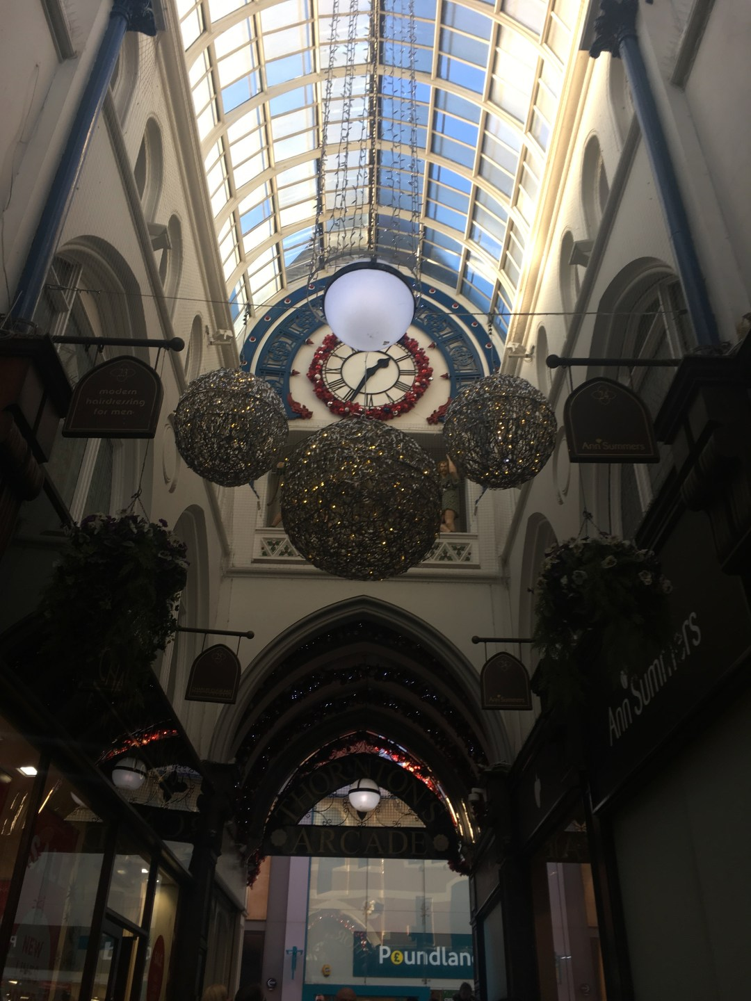 Clock at the entrance inside shopping arcade in Leeds