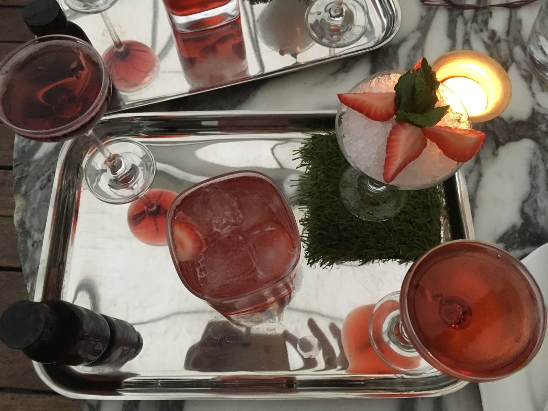 red cocktails on a silver tray