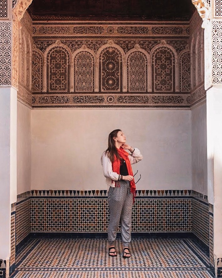 woman looks up while standing in tiled room