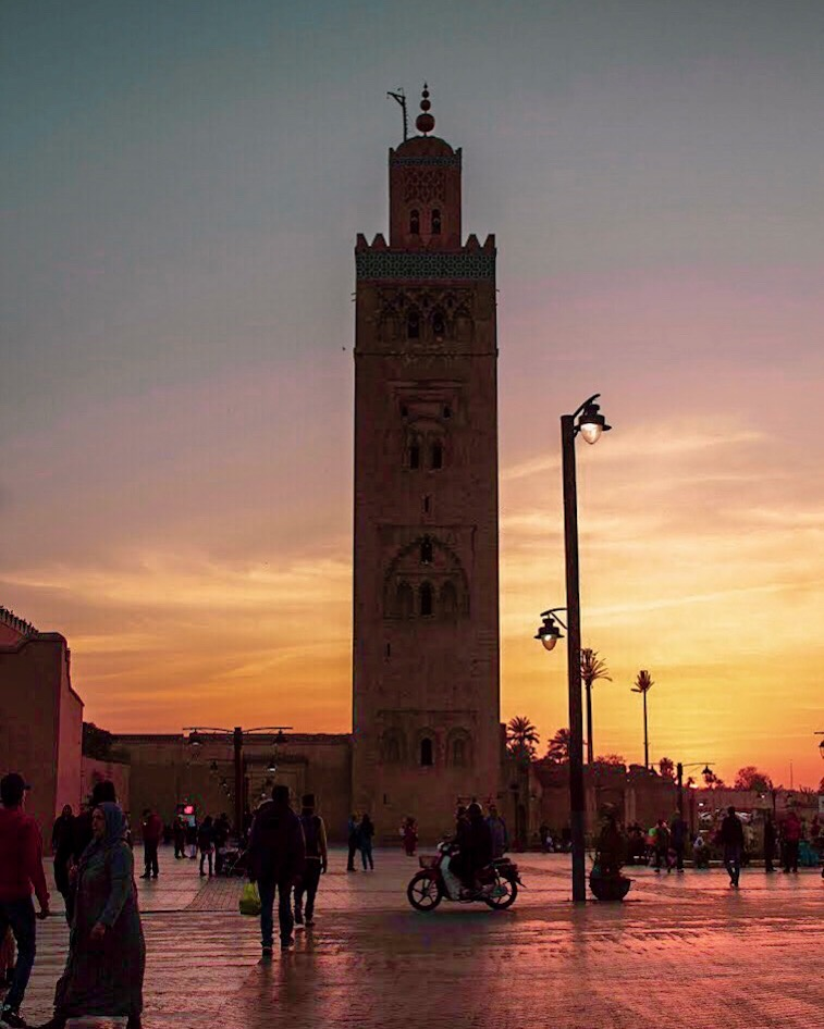 sunset behind koutoubia mosque tower
