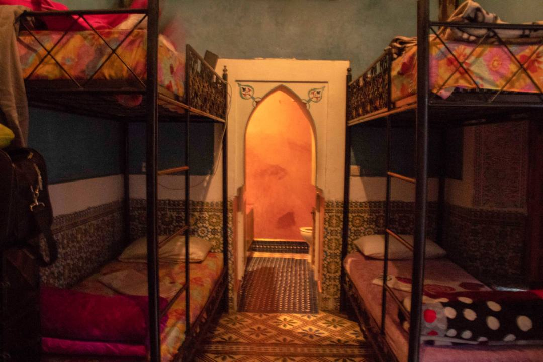 bunk beds and ensuite bathroom in dorm room in riad layla rouge marrakech
