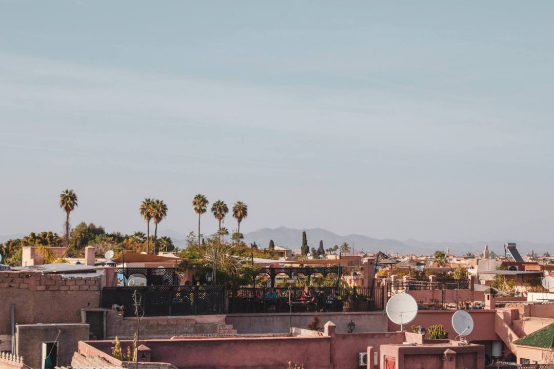mountains in the distance over rooftops in Marrakech