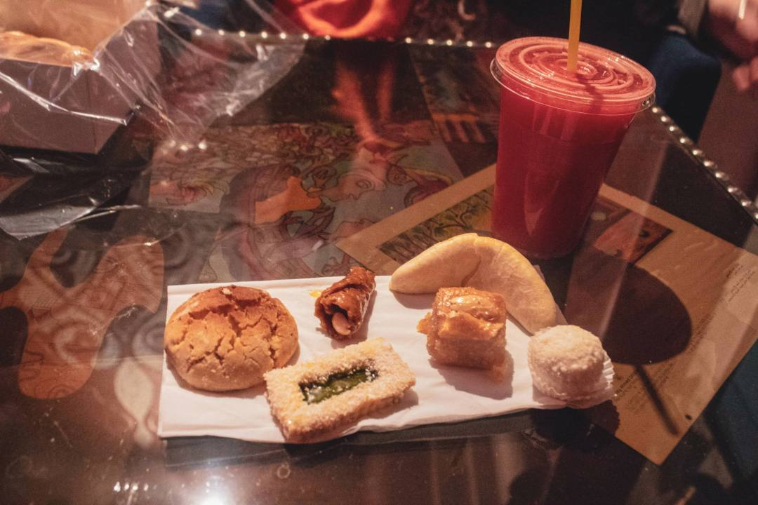 sweet Moroccan pastries and smoothie on table