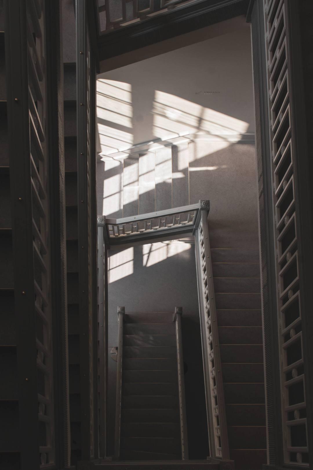 Sunlight illuminates dark staircase in palace tower