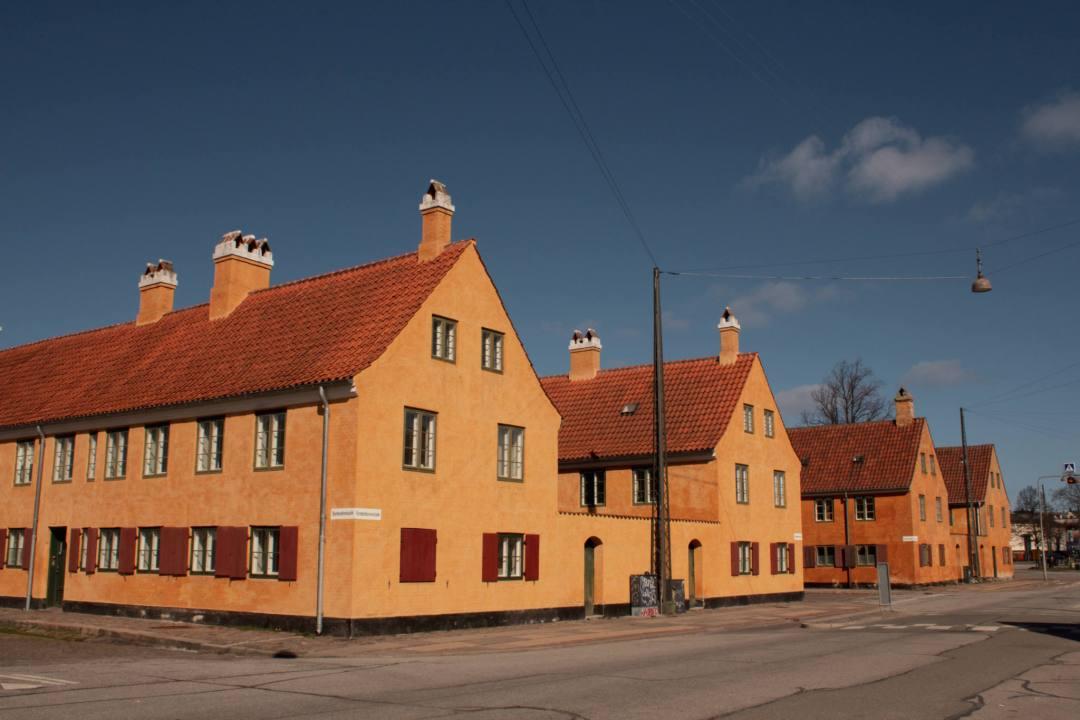 bright orange houses in Nyboder Copenhagen