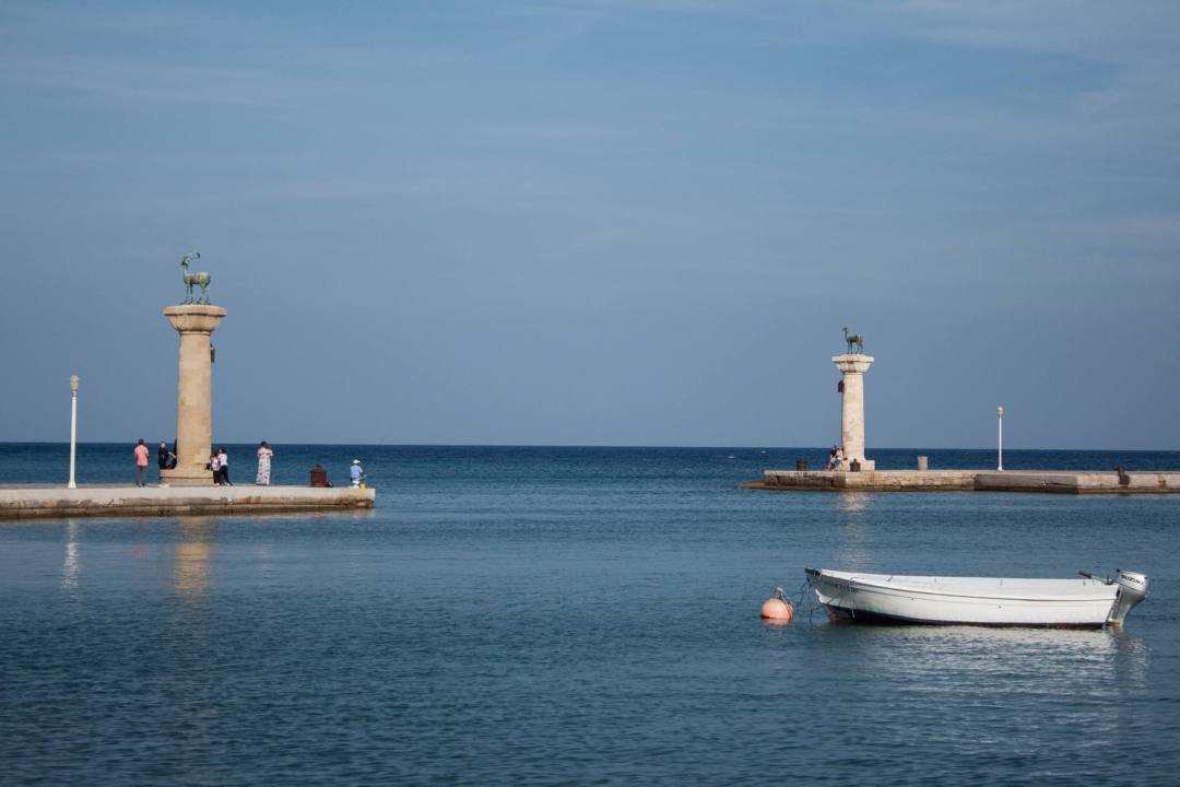 Harbour entrance with two statues in Rhodes