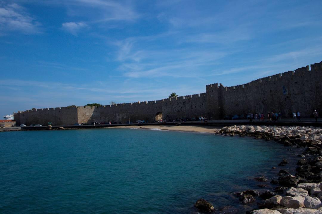 City wall in Rhodes overlooking blue ocean