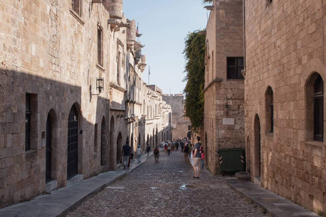 People walking along medieval street of the knights in rhodes