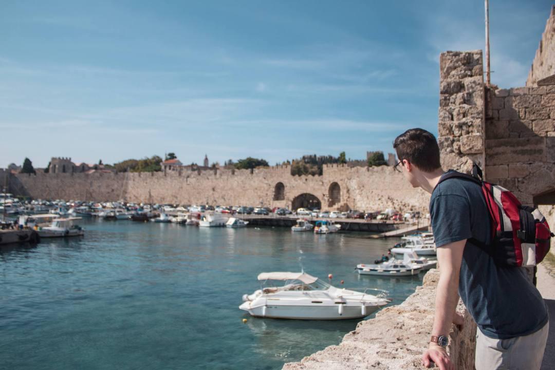 man looking over harbour in Rhodes