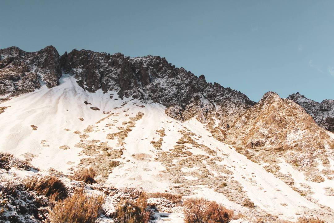 sunlight illuminating snowy mountain peaks