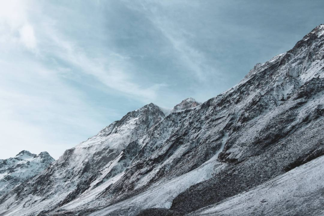 snowcapped mountain ridgeline in new zealand
