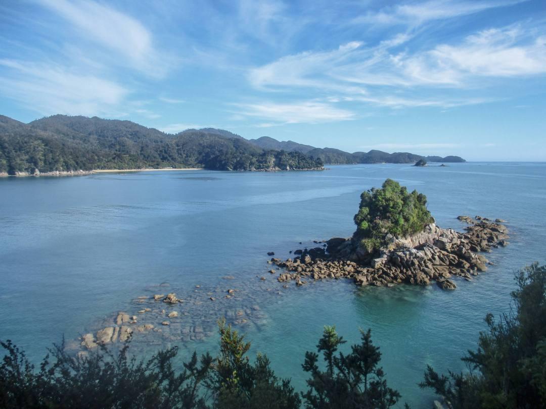 views over rocky ocean bay in abel tasman national park