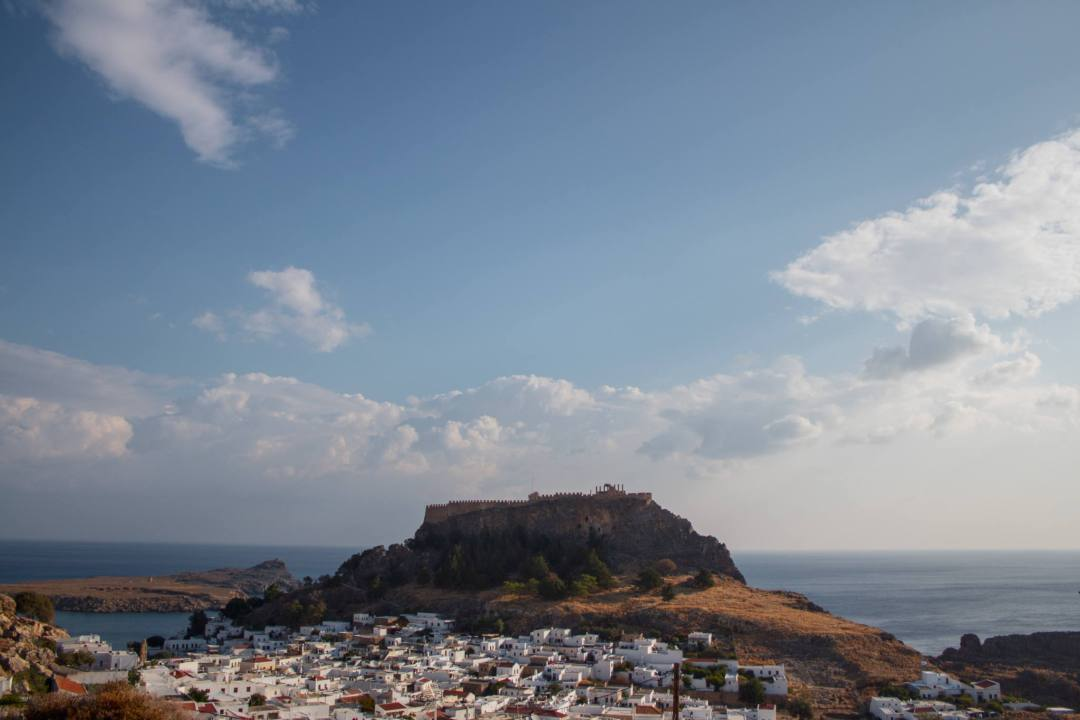 View overlooking lindos acropolis village and ocean bays on sunny day