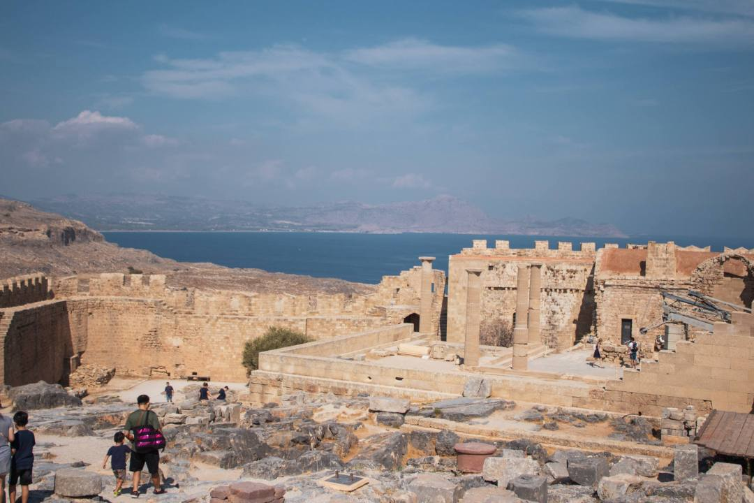 ruins of Acropolis of Lindos with ocean views behind