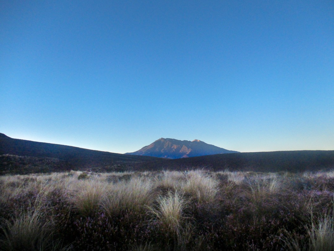 Tongariro Alpine Crossing at sunrise overlooking volcano