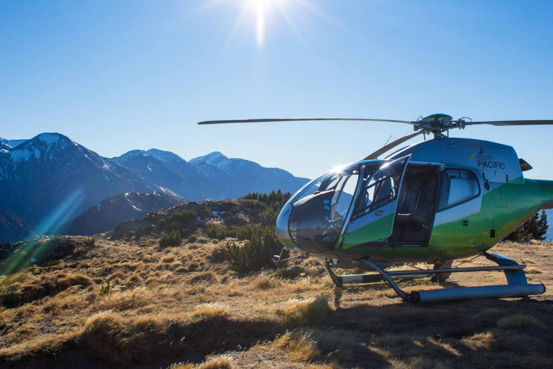 helicopter with mountains behind