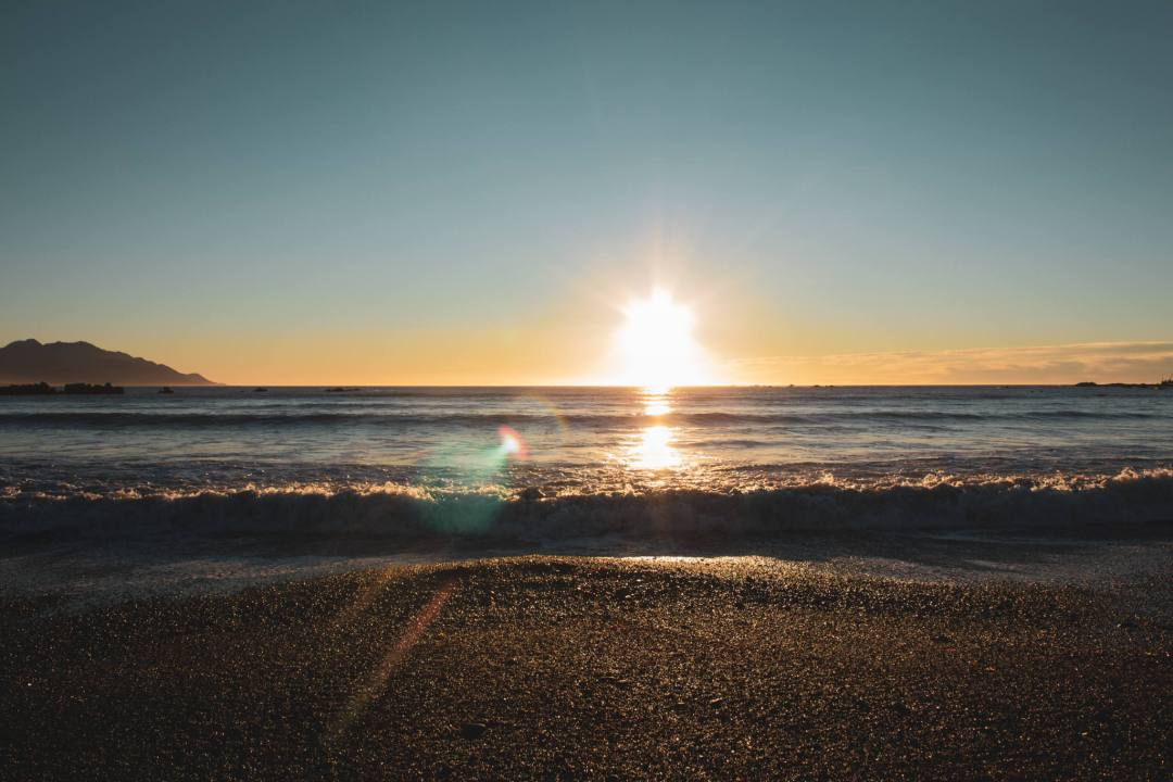 sunrise at the horizon over beach