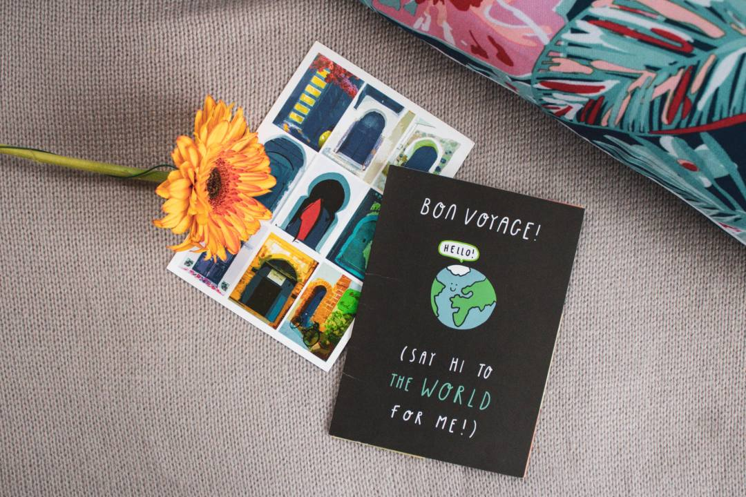 postcards and flower flatlay