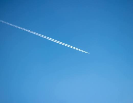 plane flying through sky