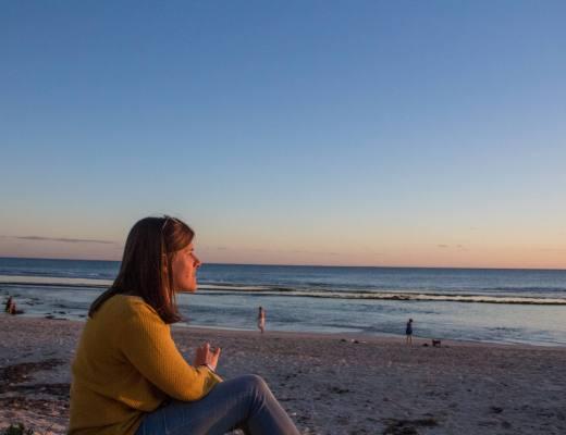 woman overlooking ocean sunset