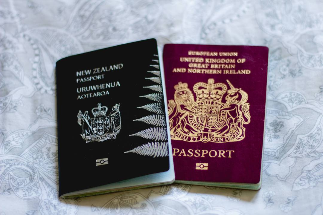 new zealand and united kingdom passports side by side