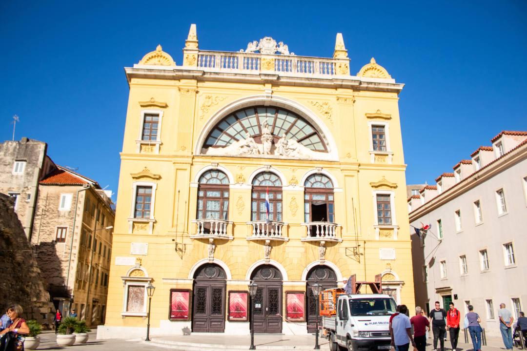 yellow theatre building in split