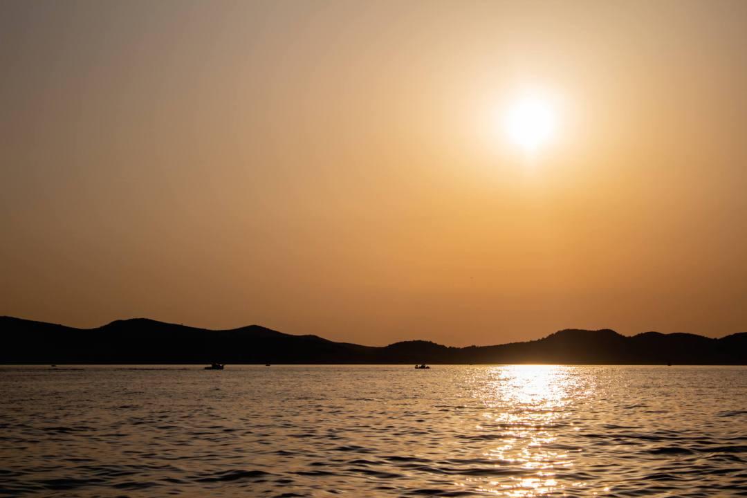 orange glow sunset over ocean