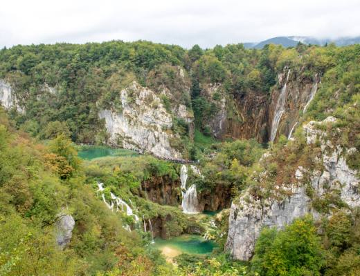 overlooking plitvice lakes waterfalls and forest