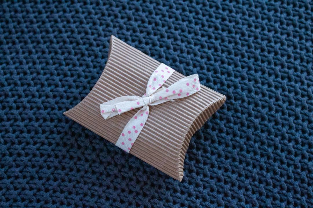 small cardboard gift box with bow