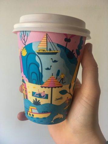 hand holding takeaway chai latte in perth