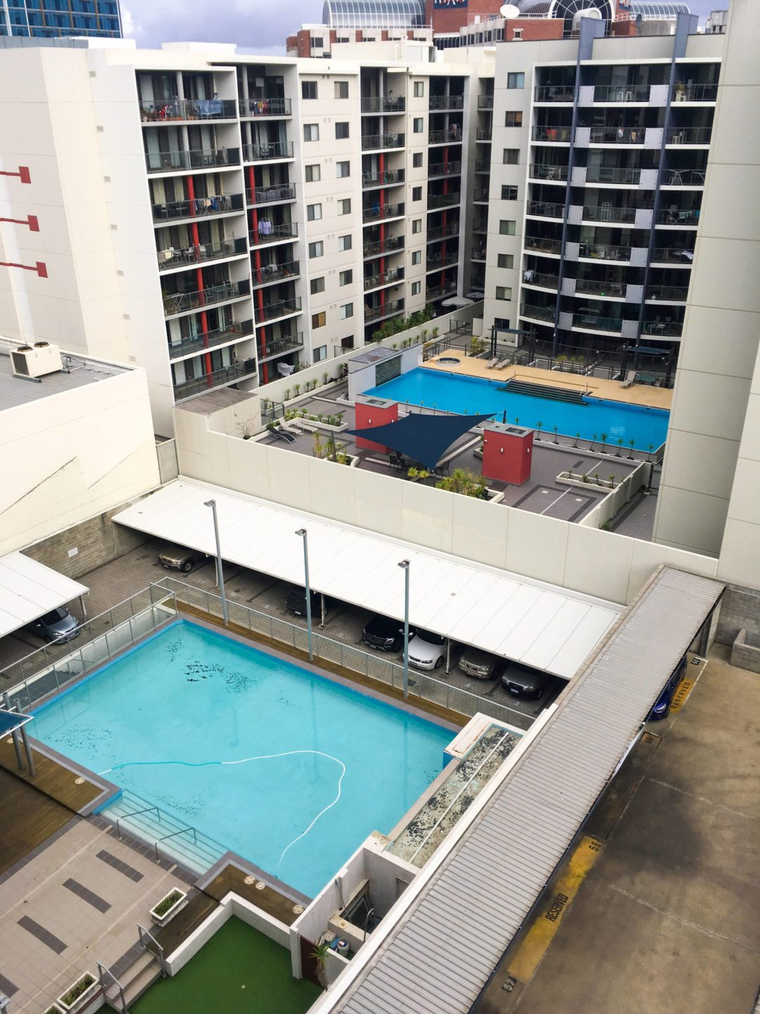view over apartment complex pools from east perth flat