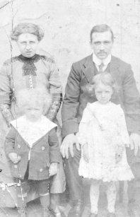 Catherine Black and Alexander Cruden with children Stewart and Margaret. Circa 1912.