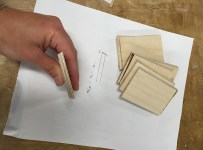 Box pieces cut on the table saw to form a precise octagon