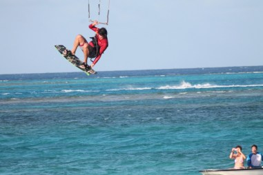 Kiteboarder taking a jump off Saba Rock (courtesy of www.fraserrustics.com)