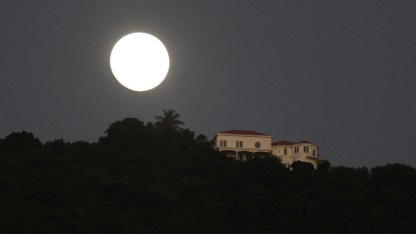 Moonrise over Cane Garden Bay (courtesy of www.fraserrustics.com)