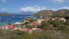 Bourg des Saintes on Terre de Haut with Fort Napolean on the hill right center and Guadeloupe in the background